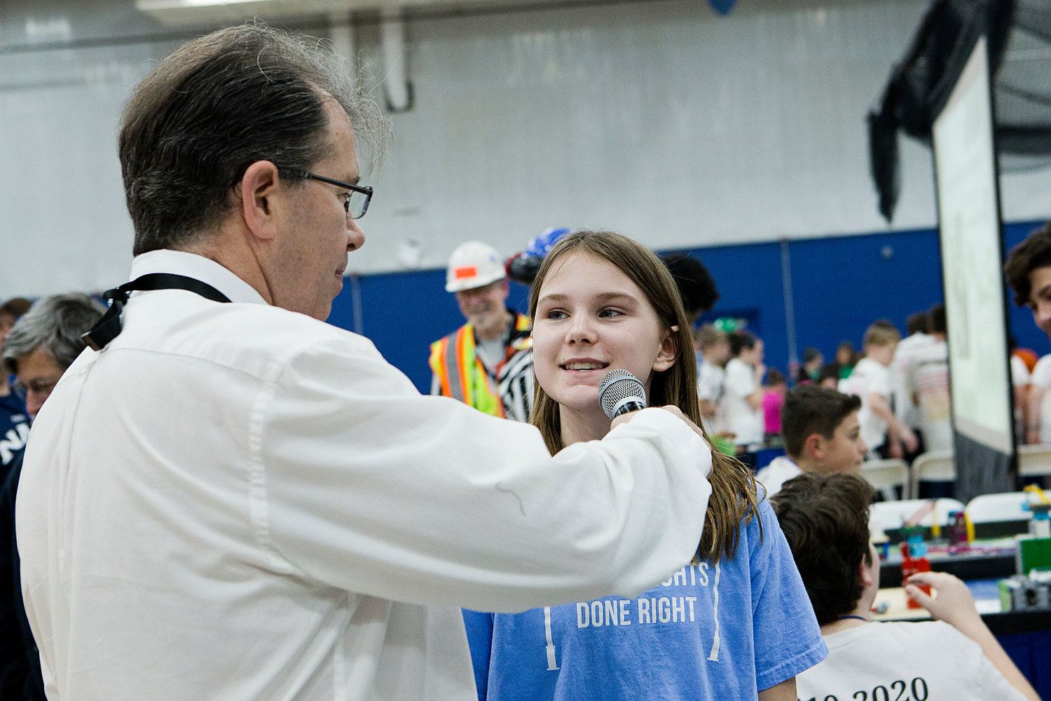 "Avary Serpa of the St. Philomena School's ""Street Lights Done Right"" robotics team is interviewed by Master of Ceremonies Matt Stein before competing in round two of the First LEGO State Championships, held at Roger Williams University on Saturday."