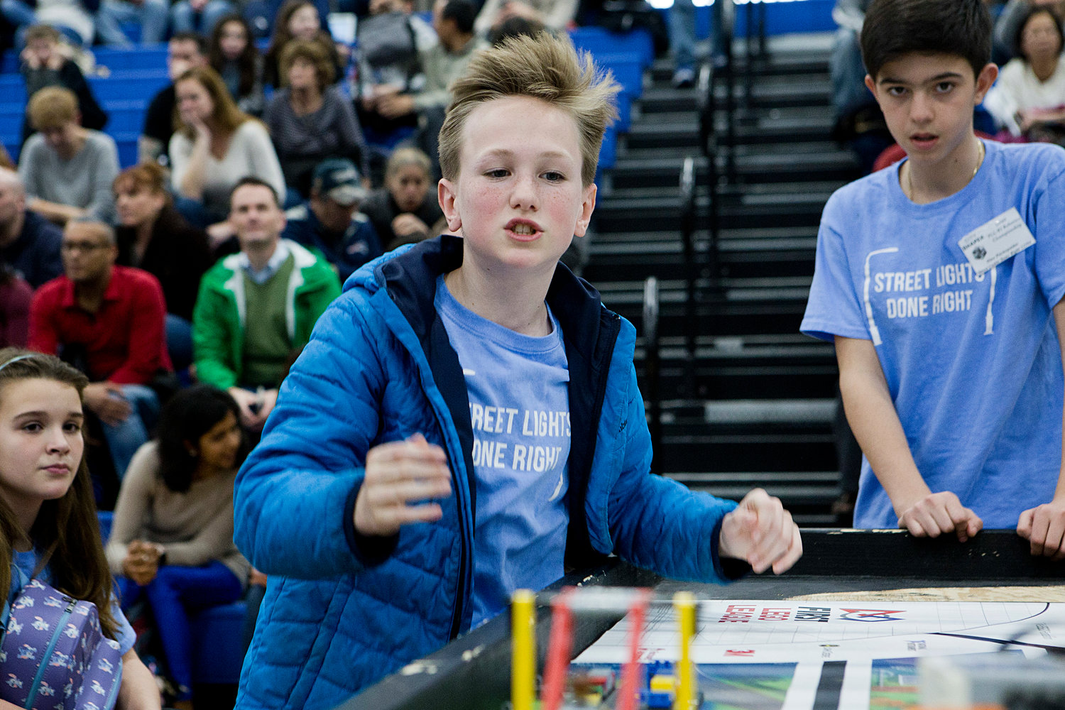 Mick O'Hara reacts to the robots' performance during round two of the First LEGO State Championships at Roger Williams University, Saturday.