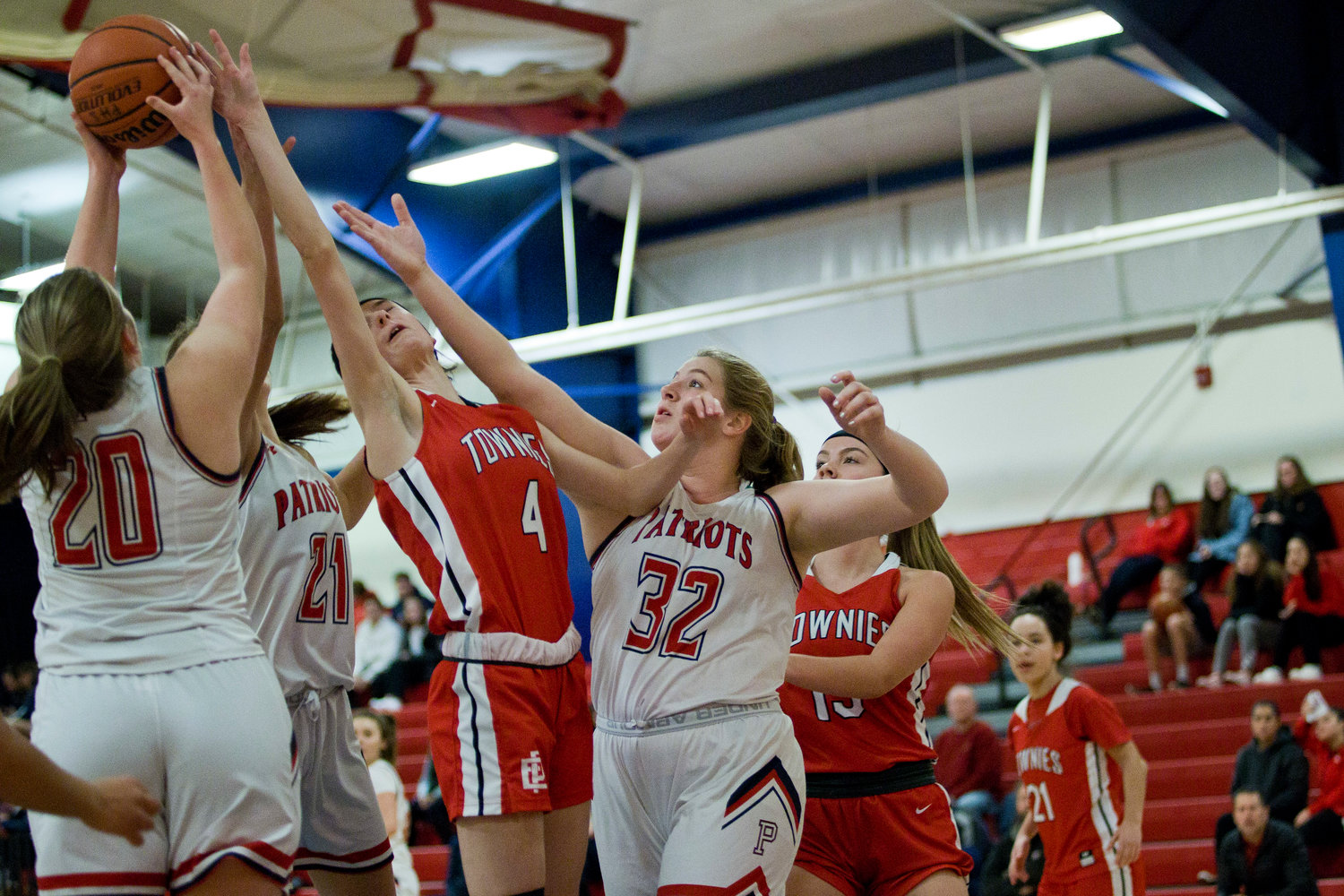 Gabby Schneck feeds the rebound toward teammate Kendall Ferris during a home game against East Providence last Thursday.
