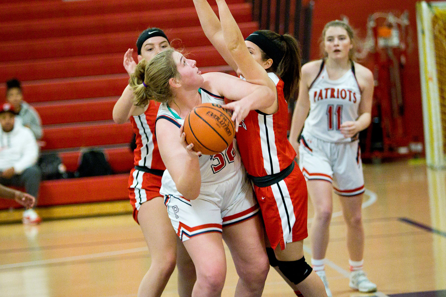 Gabby Schneck is pressured by an East Providence opponent while making a shot.