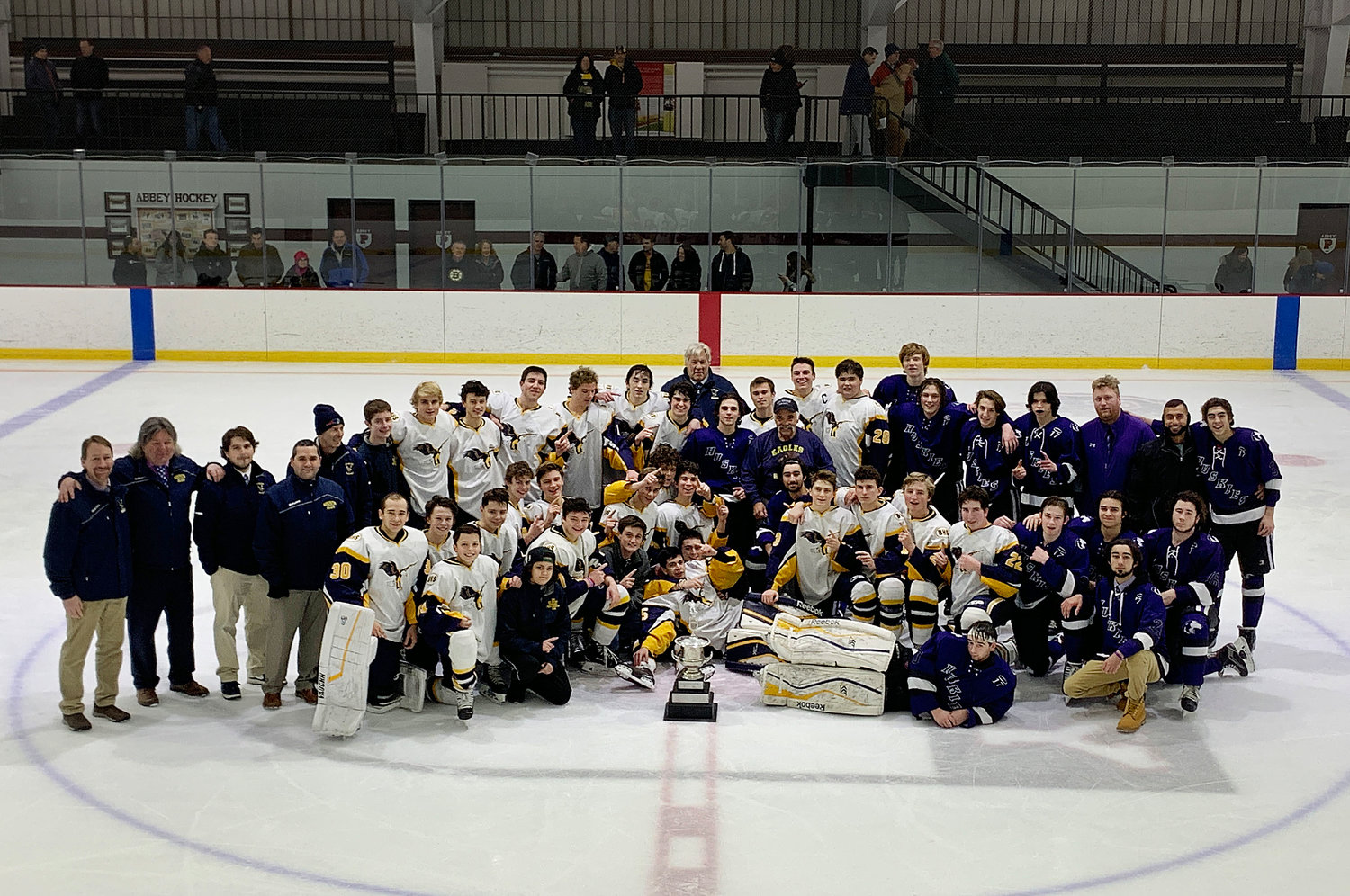 Members of the Barrington High School and Mt. Hope boys hockey teams gather for a group photo following the annual JP Medeiros Memorial Cup hockey game on Jan. 8. Barrington won, 8-1.