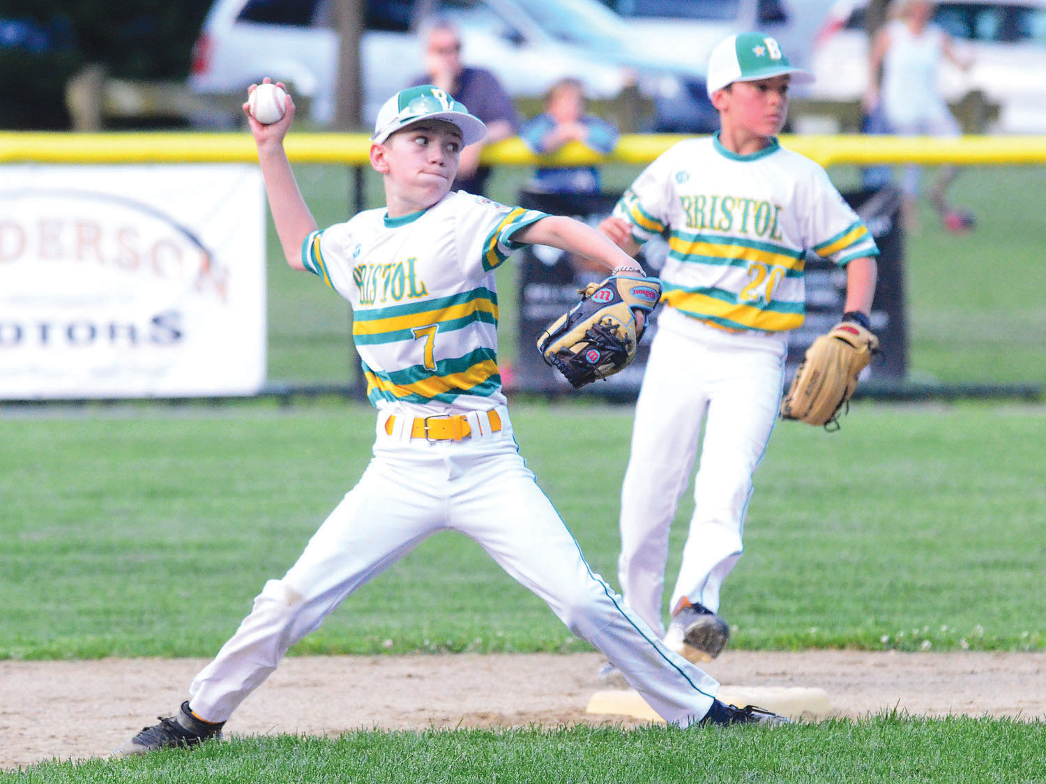 Logan Dubois fires a throw to first base during a King Philip Little League all-star game last summer.