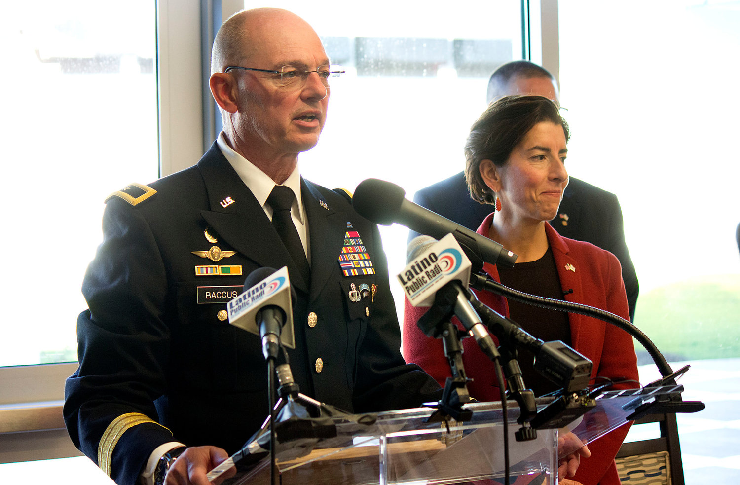 Retired Army Gen. Rick Baccus and Gov. Gina Raimondo during happier times, at the opening of the new Rhode Island Veterans Home on Veterans' Day in 2017.