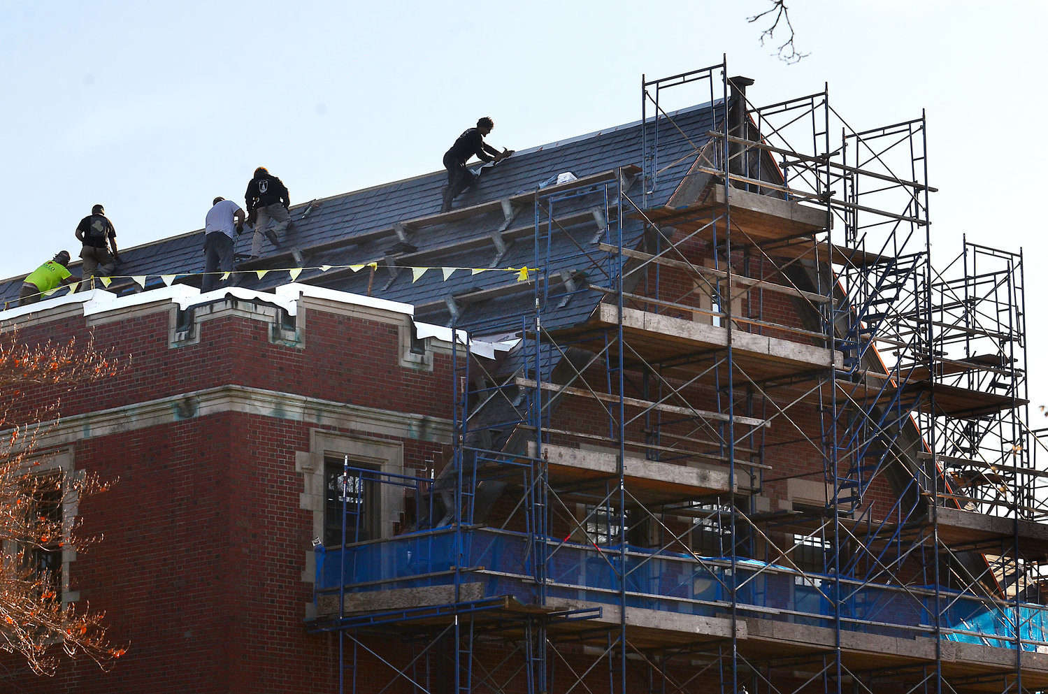 Workers from Apollo Roofing and Sheet Metal replace the roof atop the Peck Center building on Wednesday, Jan. 15. The roof replacement is part of a multi-phased project which also includes improvements to the Adult Enrichment Center and Tap-In.