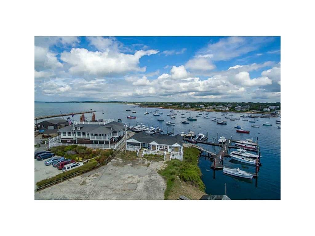 Photo from the property listing shows 7 Bluff Head Avenue immediately to the right (east) of the Sakonnet Point Club looking north across Sakonnet Harbor and up the Sakonnet River.