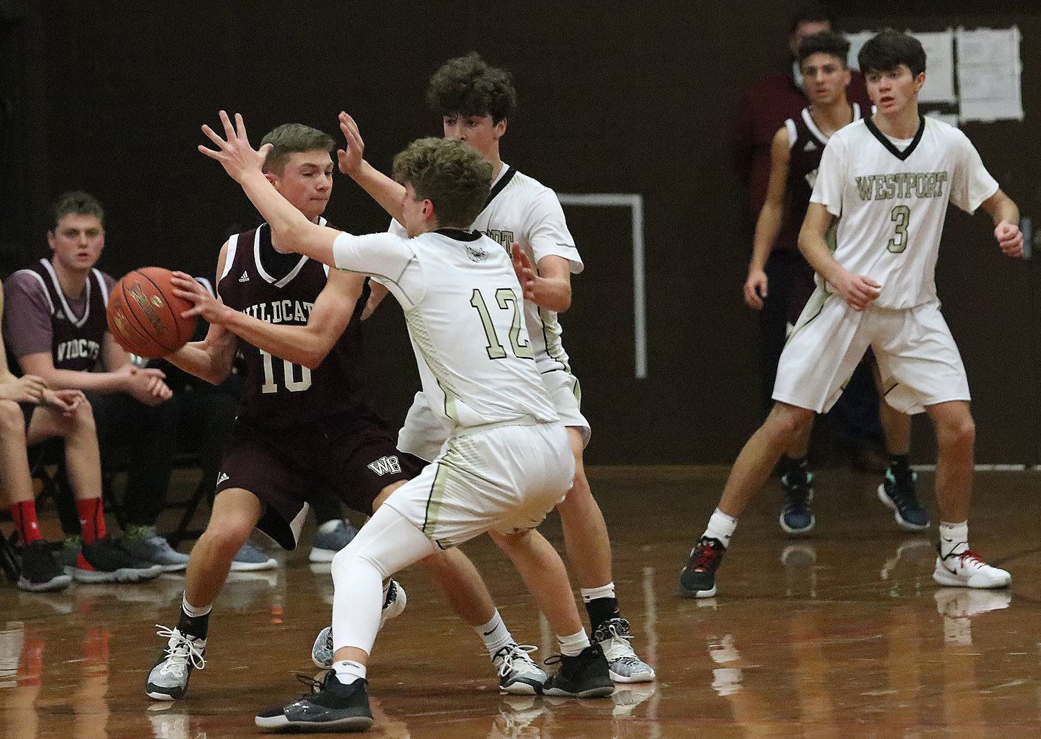 Max Mendell (left) and Max Powers double team West Bridgewater's Ryan Hulme with Aidan Viveiros looking on.