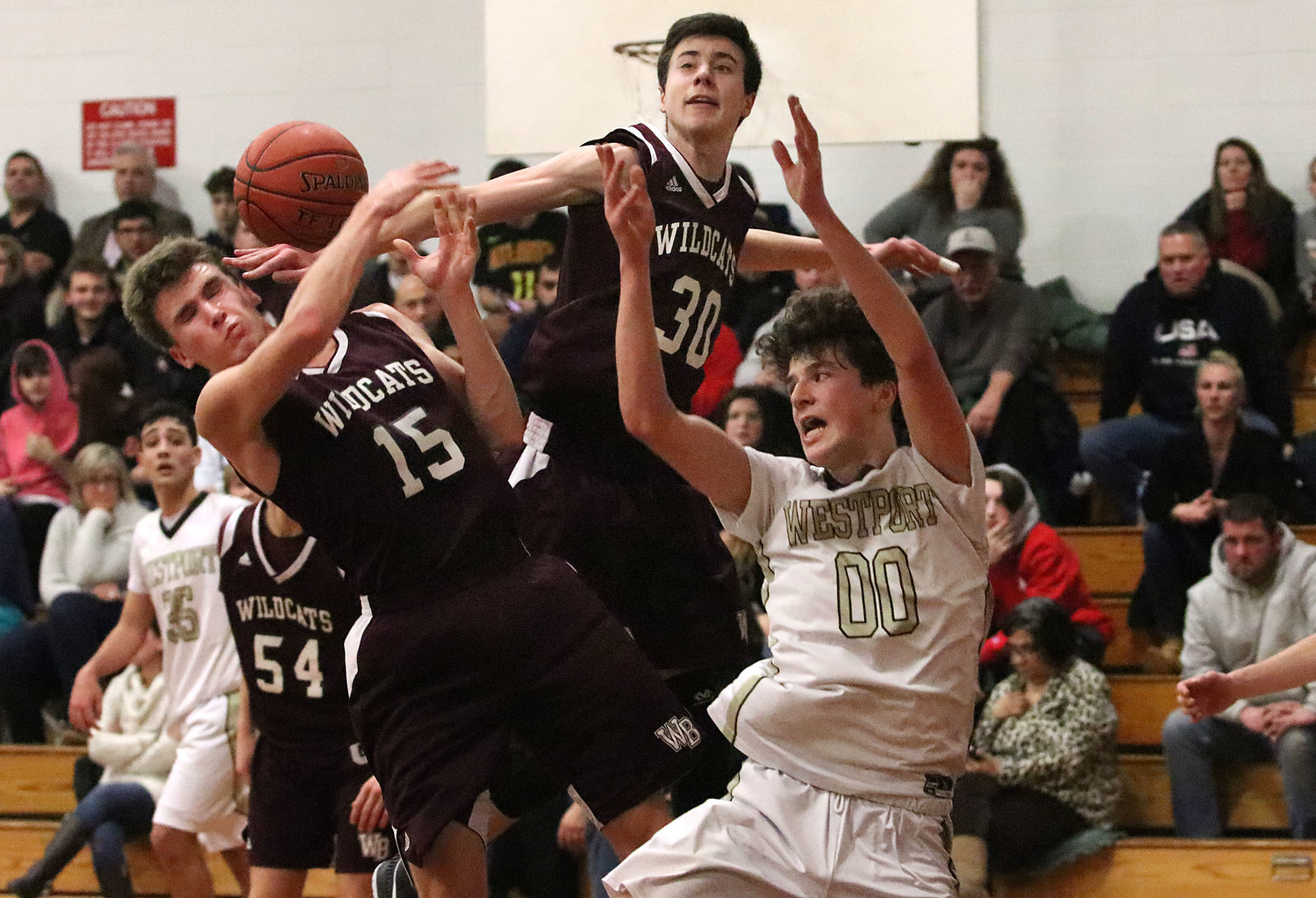 Junior forward Max Powers looks on as West Bridgewater teammates vie for a defensive rebound in the first half.