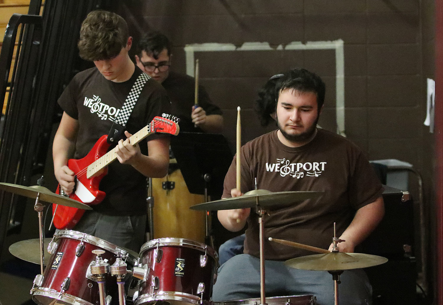 "Guitarist Ethan Tripp (left) and drummer Mike Braga play ""Crazy Train"" with the Westport Pep Band during a time out."