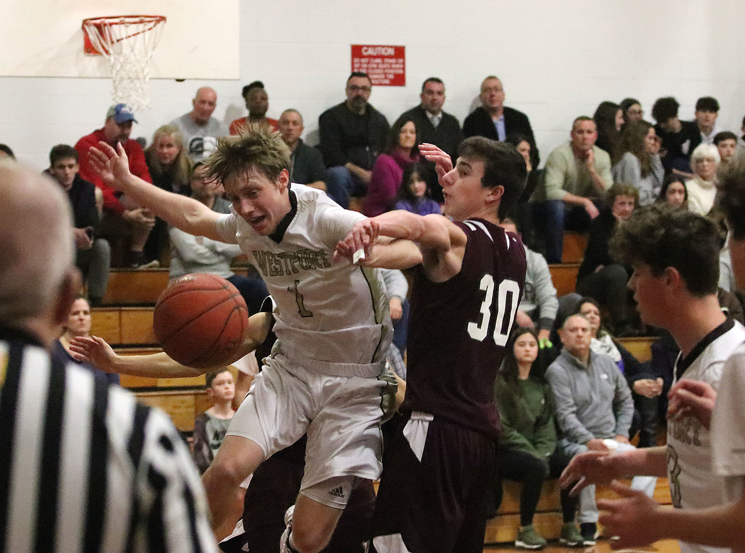 West Bridgewater's Zach Bellody taps the ball away from Connor Lecomte as he was heading towards the basket.