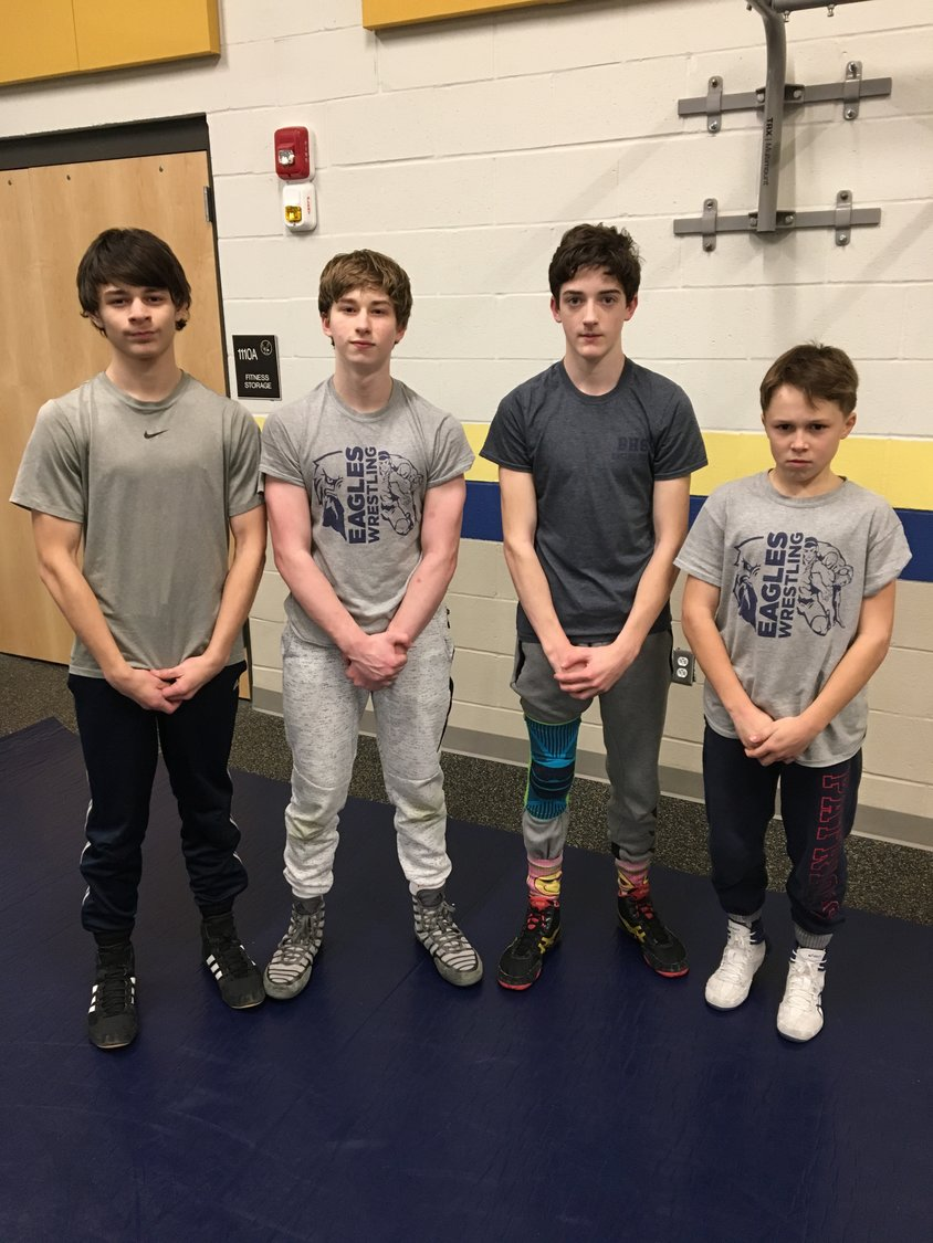Barrington Middle School wrestling team captains (from left to right) Sean Zimmerman, Jackson Cortese, Hunter Hughes and Kevin Robinson pose for a photograph.