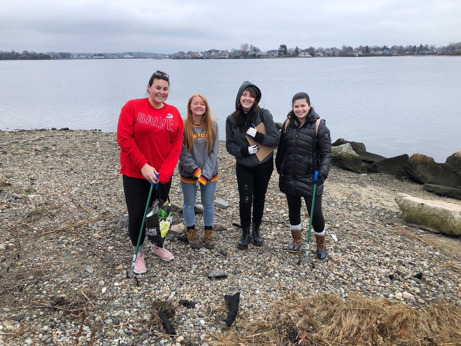 Students from Salve Regina University were among the volunteers who helped out at the Gull Cove cleanup on Saturday.