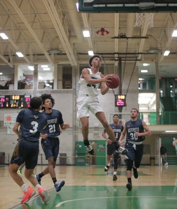 East Providence product Mitchel Noresca in action against Bristol February 4 when he broke the CCRI men's hoops rebound record.