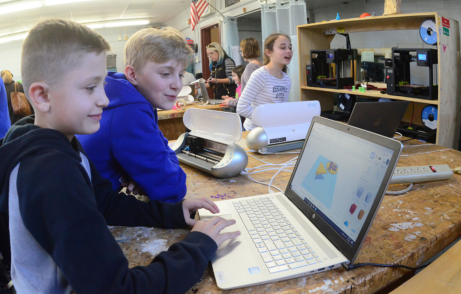 Sixth-graders Logan Allen (left) and Jack Ellsworth work on a 3D project during a Kickemuit Middle School class.