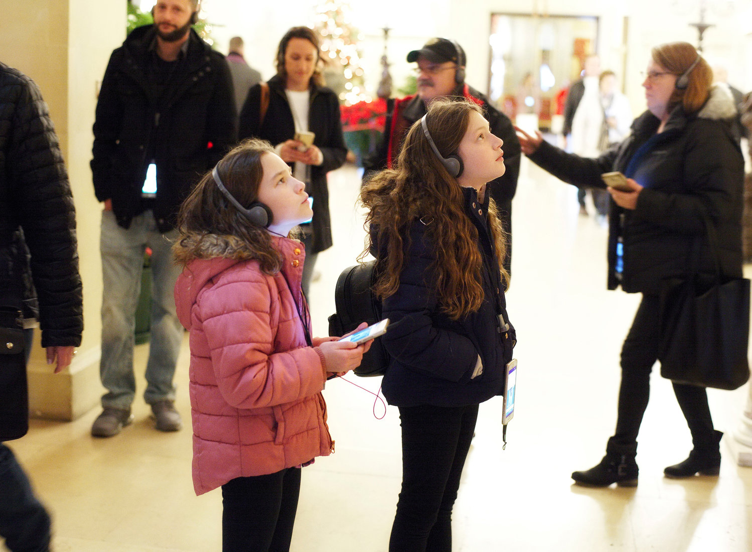 Children listen intently to the audio tour at The Breakers in Newport in December 2019.