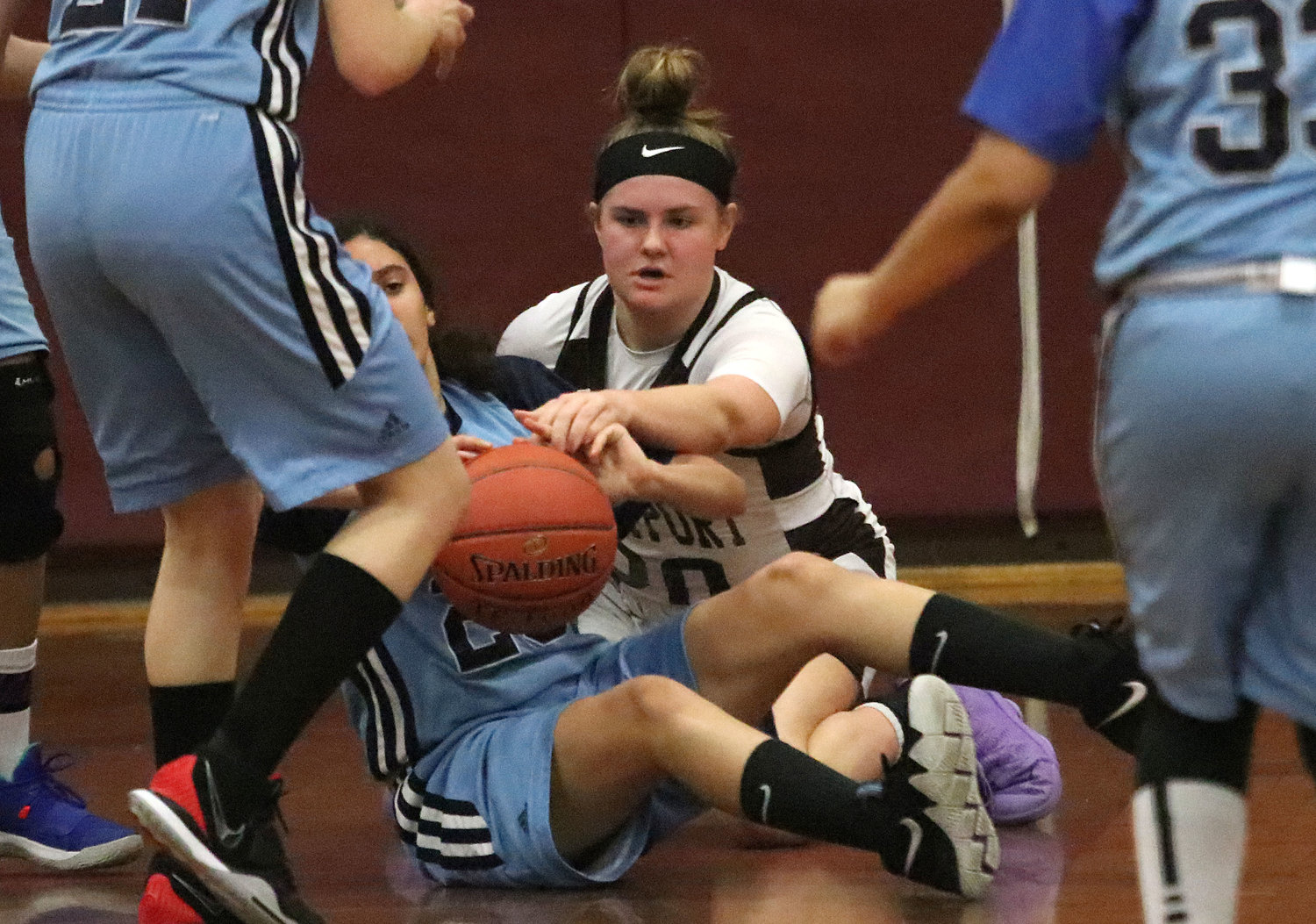 Team captain Jess Carney fights for a loose ball.