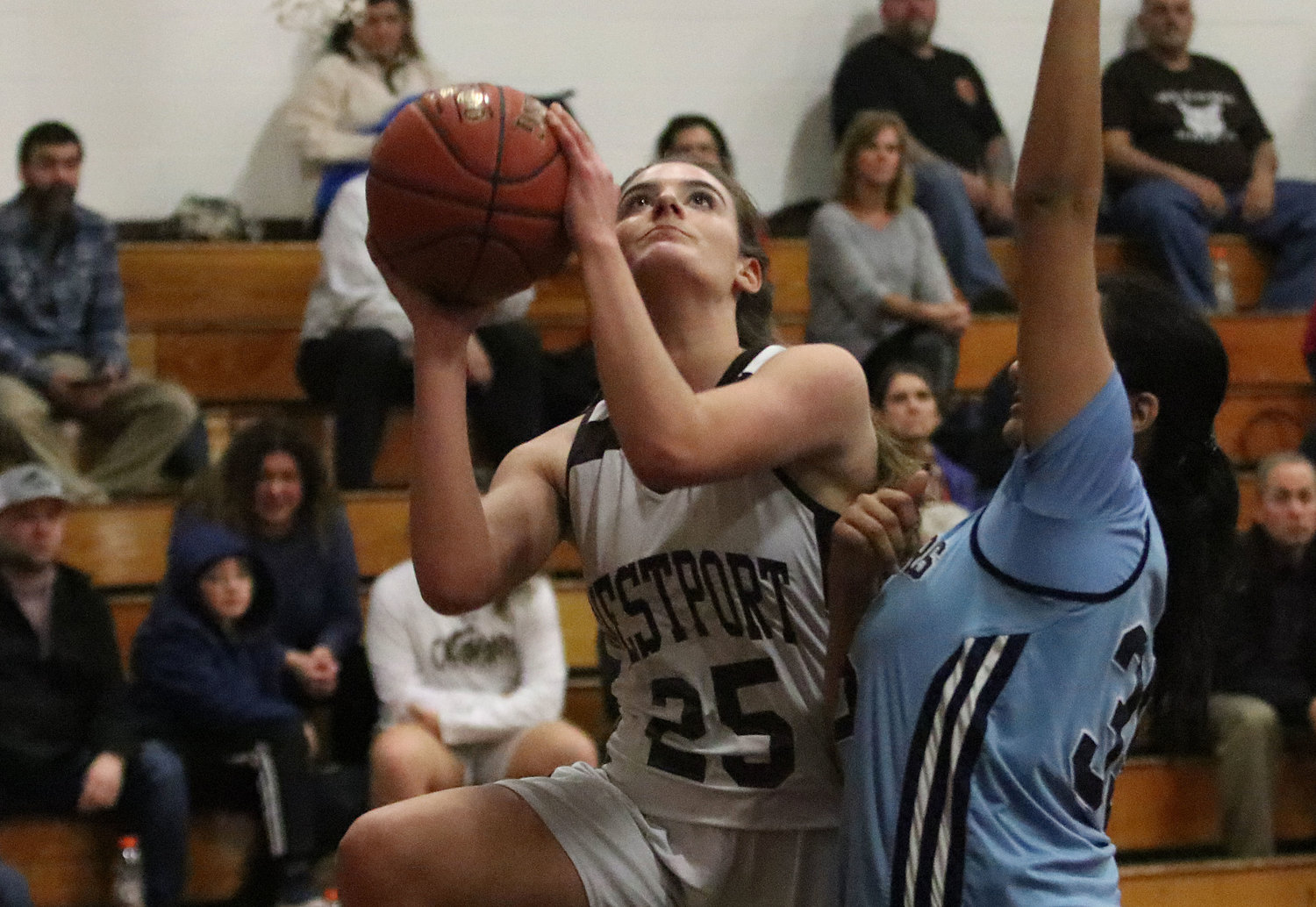 Sophomore forward Lily Pichette drives the lane for a layup.