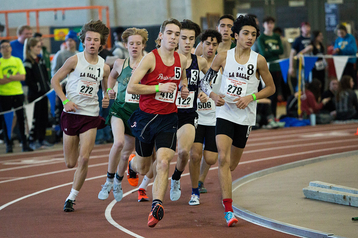 The Patriots' Ben Chase keeps pace at the head of the pack while competing in the boys' 1,500-meter run.