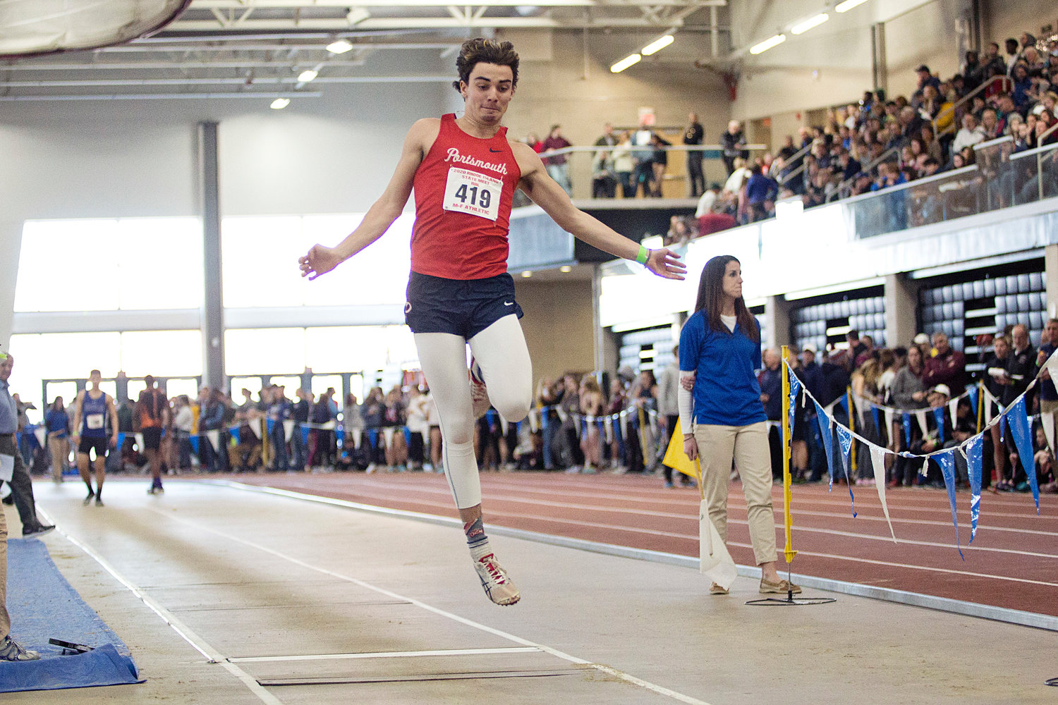 Brady Cranson propels himself while competing in the boys' long jump 