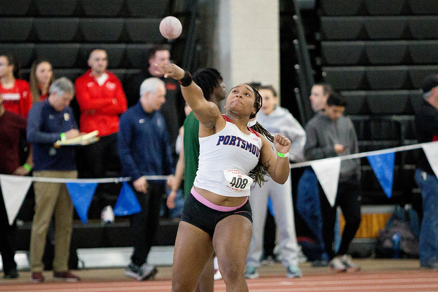 Portsmouth High School's Gabby Bryan gives her best effort while competing in the girls' shot put event at the state indoor track and field championship meet at the Providence Career & Technical Academy on Saturday. Her best toss was 35 feet, 4.5 inches — good enough for fourth place, which was the highest finish among her team members.