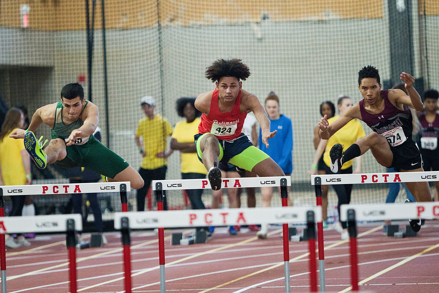 Jarlyn Soler competes in the boys' 55-meter hurdle event.