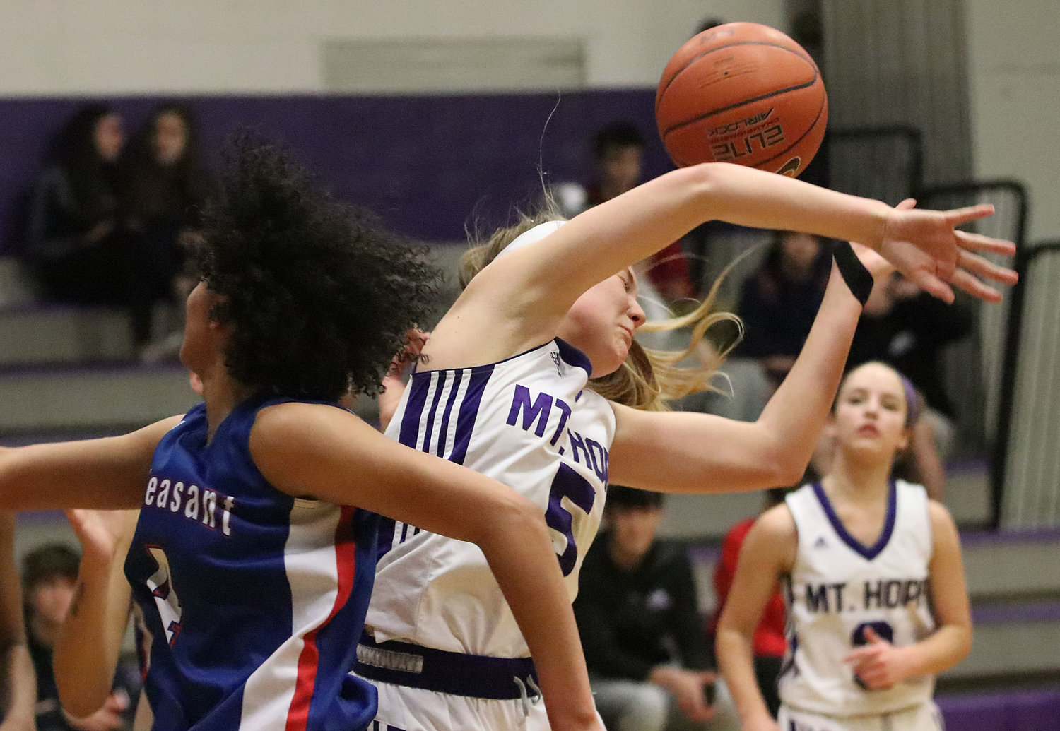 Senior forward Zoe Mouligne attempts to grab a rebound in the first half of their game against Mt. Pleasant.