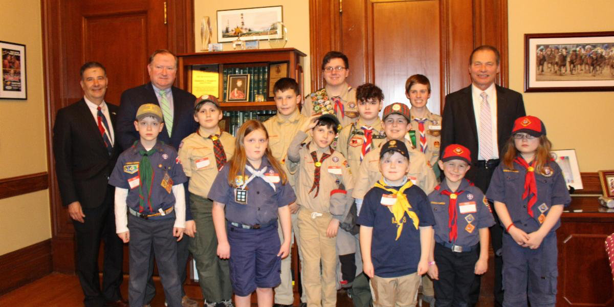 Senator Frank Lombardo, Majority Leader Michael McCaffrey and Senate President Dominick Ruggerio with members of Pack 53 Providence and Pack 1 Warwick.