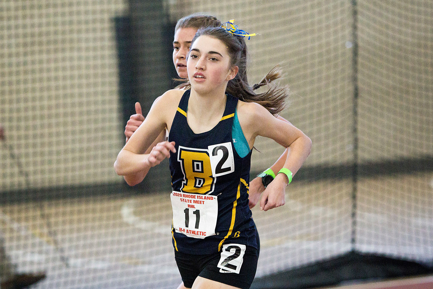 Barrington's Caroline Livingston, shown running at states, received a Bobby Doyle Foundation scholarship at the recent track banquet.