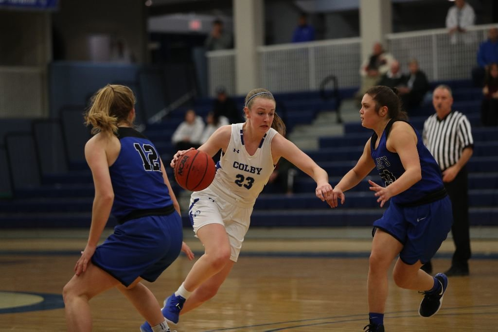 Barrington's Ainsley Burns drives hard toward the basket during a Colby College basketball game. This year, Ainsley reached the 1,000-point mark for Colby.