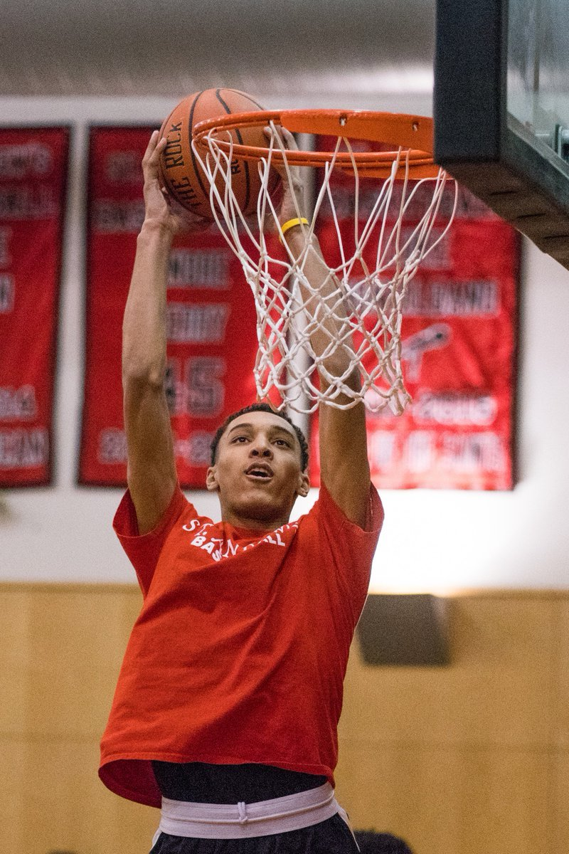 Brycen Goodine is shown elevating for a dunk during his playing days at St. Andrew's School in Barrington.