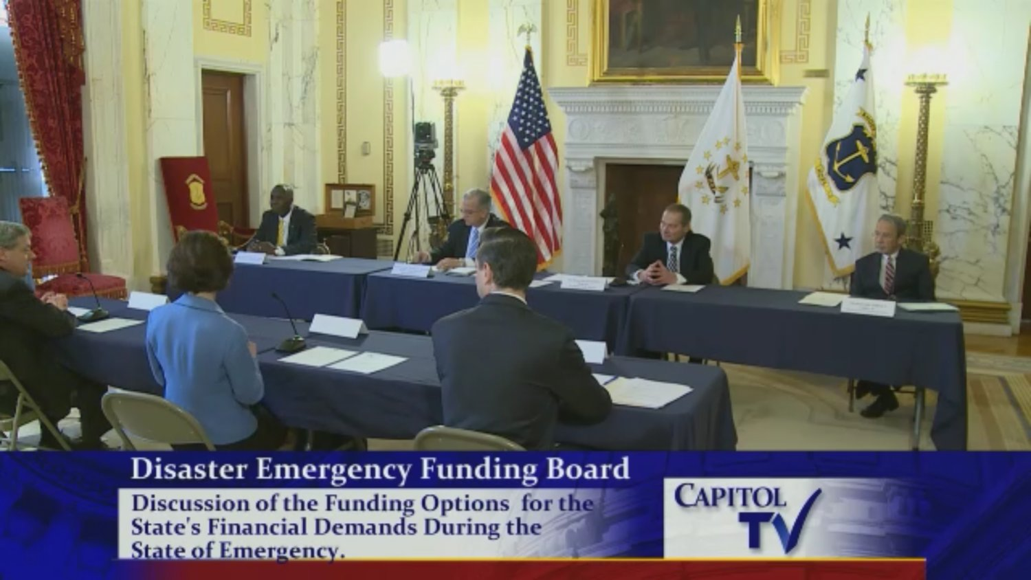 Gov. Gina Raimondo and General Treasurer Seth Magaziner appear before the Disaster Emergency Funding Board's meeting Thursday morning at the State House.