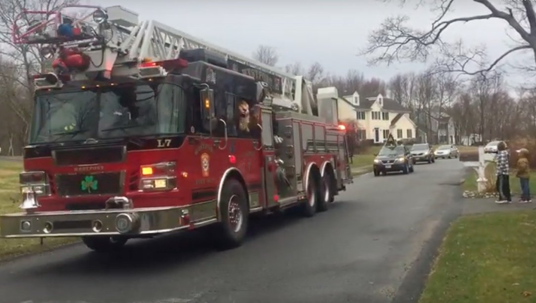 With a fire engine leading the way, teachers parade past students' homes (from Facebook video).