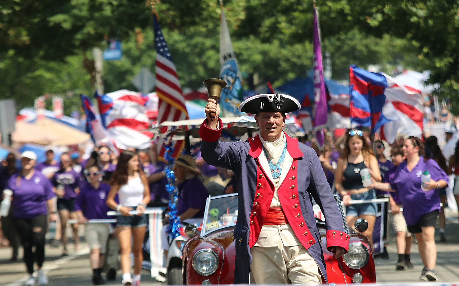 The Town Crier leads the 2019 Bristol Fourth of July Parade.