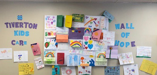 Some of the young Tiverton artists' work graces a wall at Leatherwood in Newport.