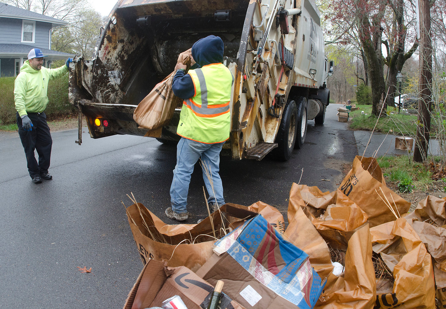 MEGA employees pick up leaf bags on Walnut Road in Barrington recently.