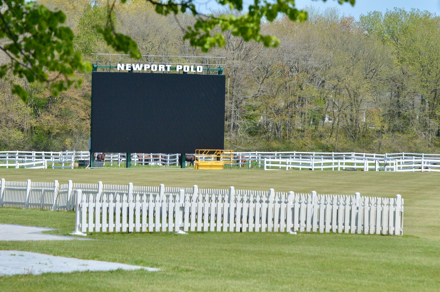 "The Jumbotron at Newport International Polo will be used to air a ""virtual crossing of the stage"" that has already been filmed."