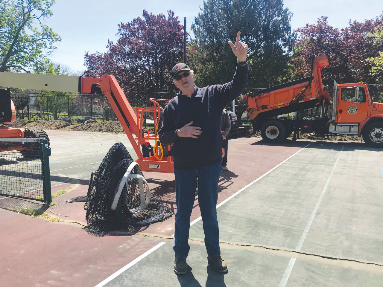 Bill VanVoast, Bristol's on-call electrician, is overseeing the installation of new electrical conduits that will illuminate the tennis courts on the Town Common.