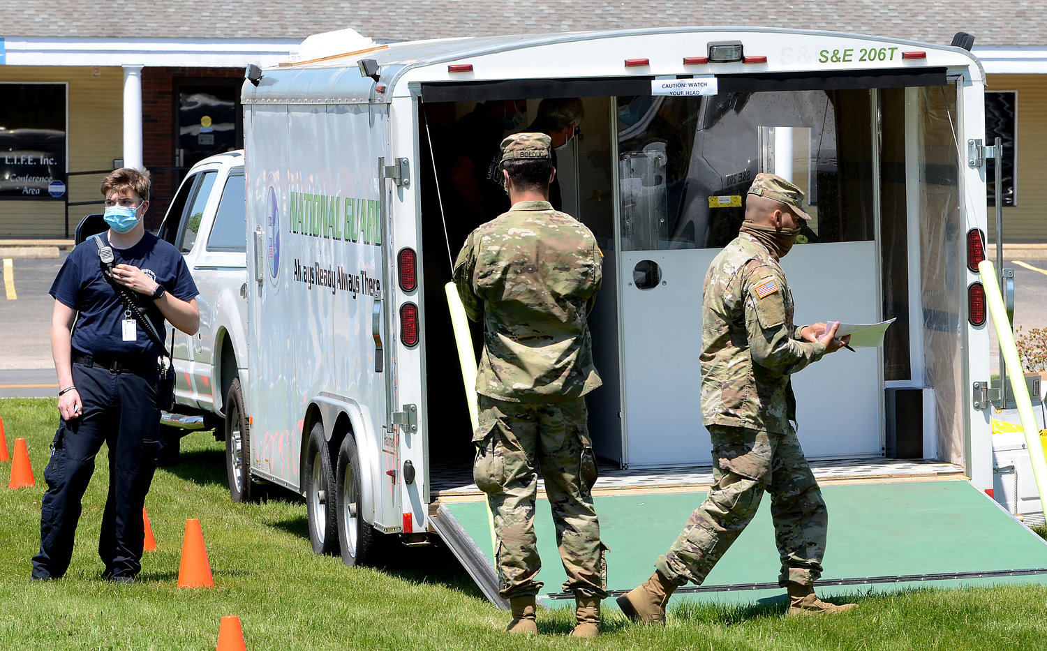 The Rhode Island National Guard set up a registration trailer for Bristol and Warren first-responders on Thursday.