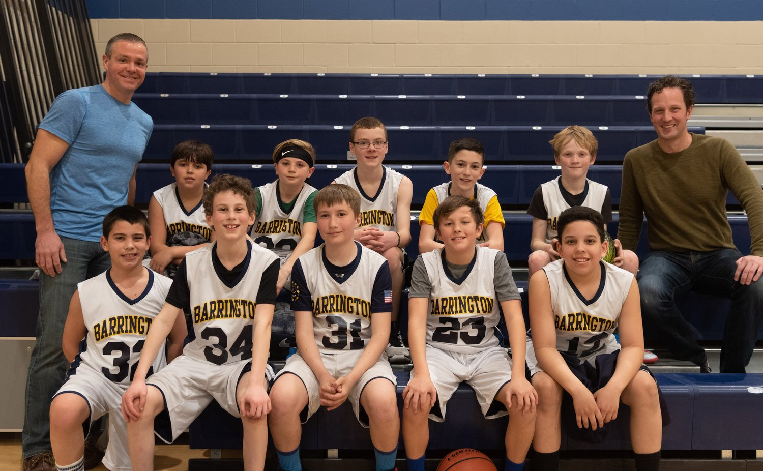Team Gold poses for a photograph following their 12-2 season. Pictured are (from left to right, front row) Brooks Mello, Zachary Sheinberg, Soren Hoffman, Myles Blount, Sanders Toman, and (back row) head coach Doug Furtado, Sam Tostes, Colin Appleyard, Charlie Furtado, Connor Gillam, Caleb Appleyard, and assistant coach Ben Appleyard.