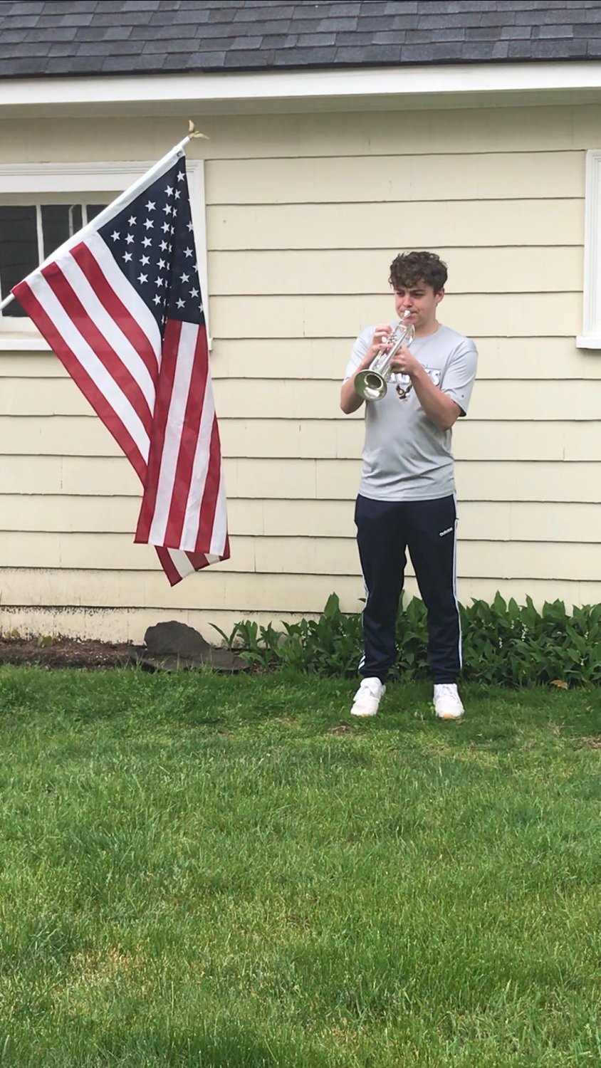 Barrington High School's Daniel Enos plays a tribute to fallen soldiers on Memorial Day.