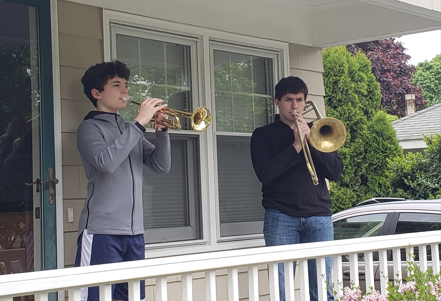 Liam O'Neal (left) and his brother Connor, both students at Barrington High School, share a musical tribute to fallen veterans on Memorial Day.