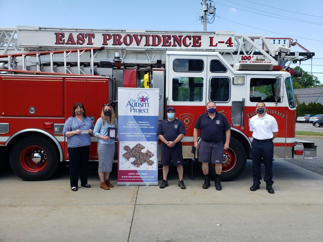 Joanne Quinn, executive director, Autism Project; Kristen Steiner, senior development manager, Autism Project; Lt. Carl Godfrin; Capt. Joseph Crowshaw and Battalion Chief Frederick MacDonald gather for the donation presentation.