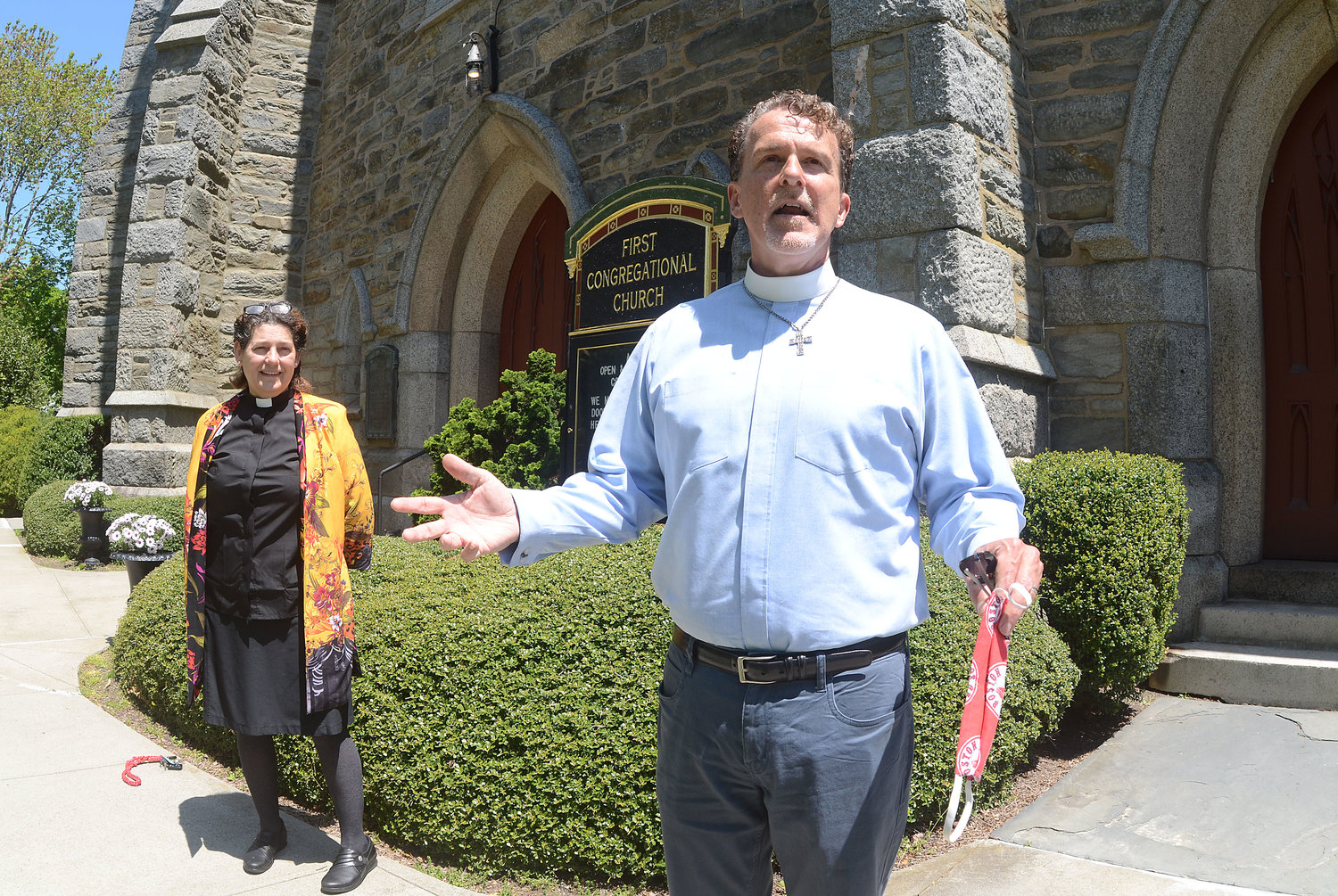 Pastor Burton Bagby-Grose (foreground) with pastor for youth and missions Hilary McLellan will be keeping the doors of the First Congregational Church closed to in-person worship, for now.