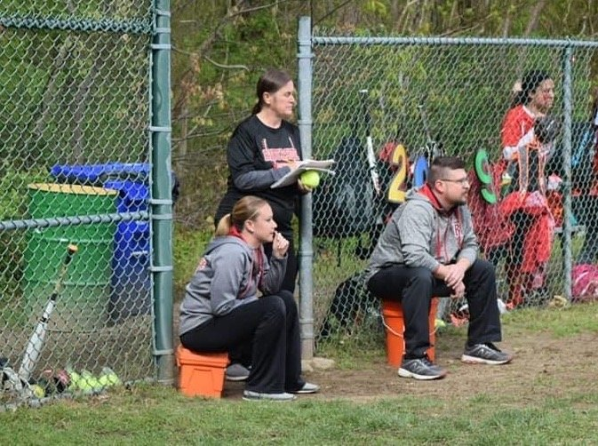 New East Providence High School softball coach Katie Kenahan (left) watches her former Riverside Middle School squad play a game last year. Kenahan was assisted at RMS by her mother Linda Gorton (standing) and Paul Mendence (right), who will also serve as her aides when the Townies return to action next spring.