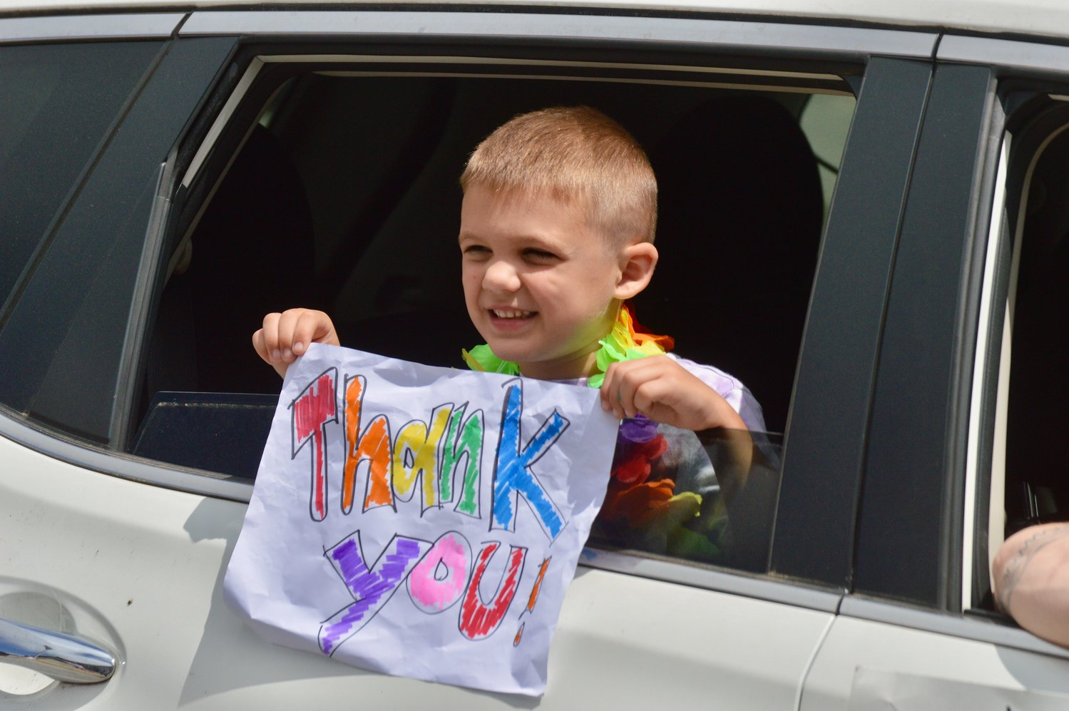 Andrew Habershaw shows his appreciation to Hathaway School teachers during a drive-by parade Thursday.