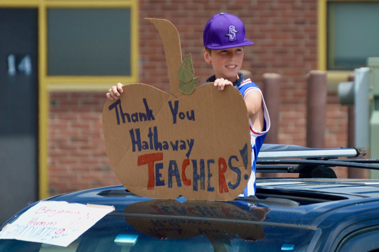 Ben Humm's sign said it all during Thursday's parade for fourth-graders leaving Hathaway School.