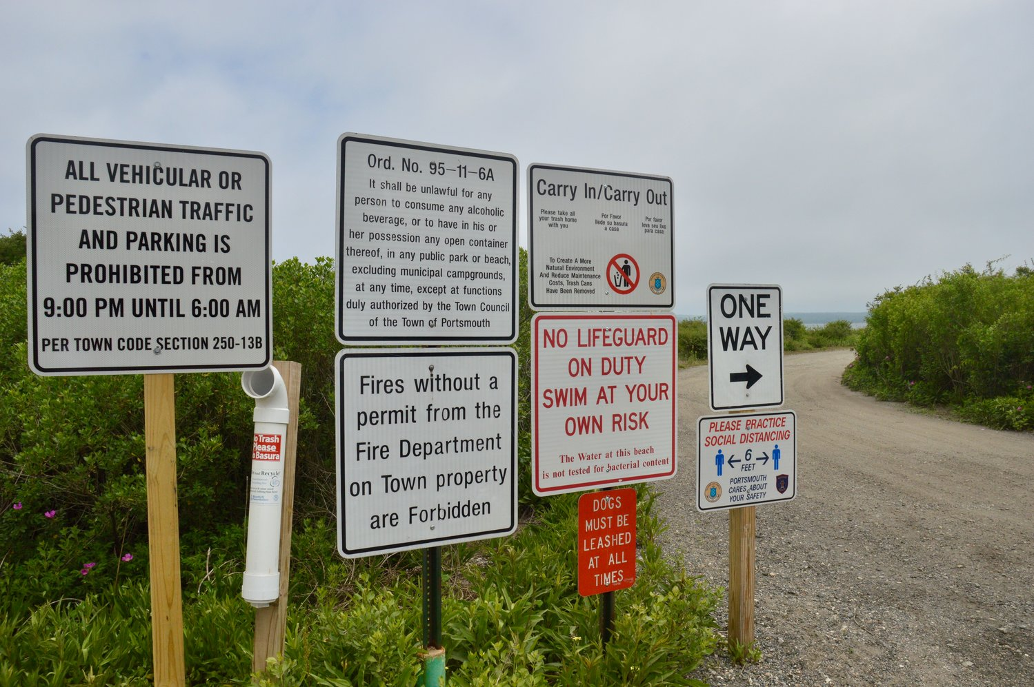 A plethora of signs greets visitors to McCorrie Point Beach, where fires are allowed by permit. The town plans to condense the messages into one placard.