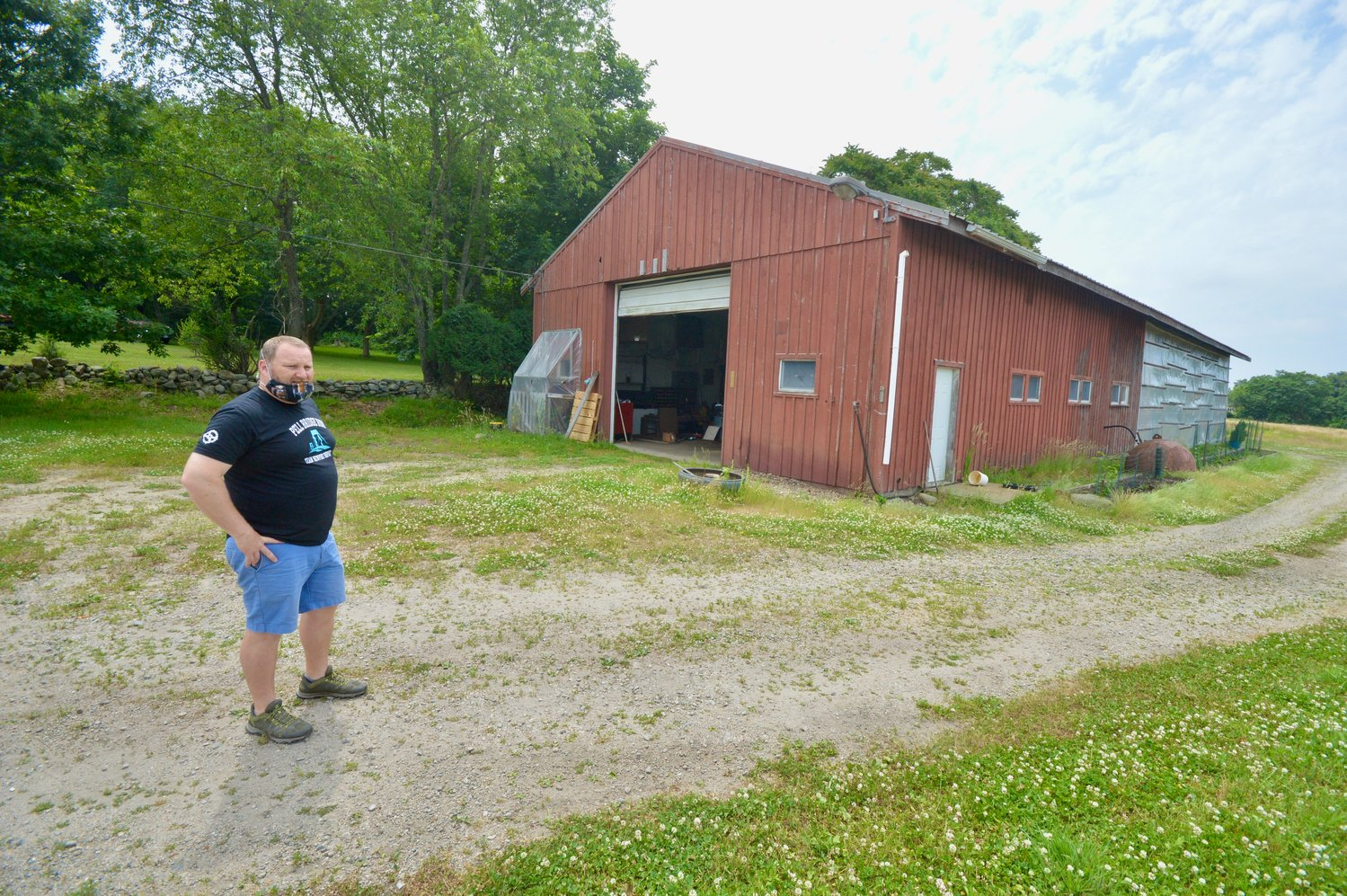 Matt Gray, president of Ragged Island Brewing Co., stands next to an old barn on the former Van Hof property that will be transformed into a taproom. The brewery has, for now, scuttled plans for a new building further west on the farmland.