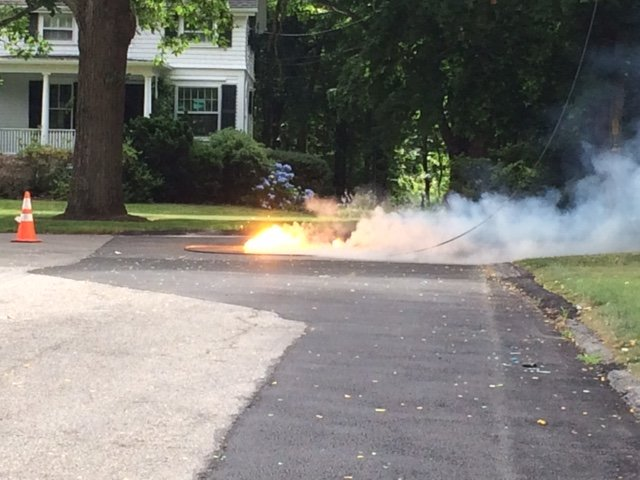 A downed electrical line burns near the intersection of Washington Road and Brook Street.