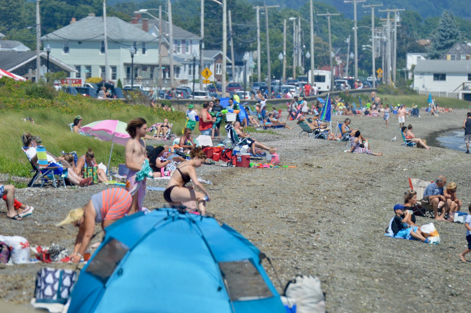 This is what the Island Park Beach looked like on the afternoon of July 19. Note the vehicles parked along Park Avenue. Town Administrator Richard Rainer, Jr. said police are patrolling the area on a regular basis, but cannot prohibit vehicles with out-of-state plates from parking there.