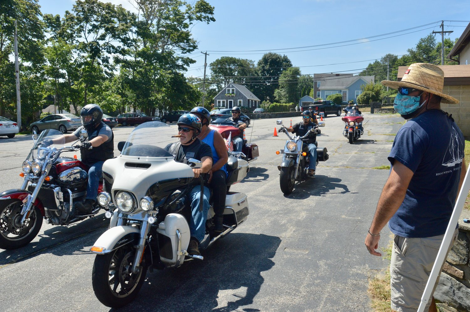 Members of the Watchkeepers Rhode Island motorcycle club arrive at St. John's Lodge No. 1, the new location for the food bank.